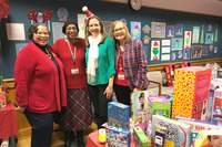 Picture of participants in front of donated gifts