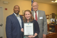 Image of Vice President of Enrollment Management Clayton Steen, left, Desiree Drindak, interim director of the Office of Veteran and Military Education, with Emil Baker, director of military outreach, New York State, who presented her award.