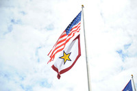 The Flag of the United States of America flies above the Gold Star Mother's and Family's Day flag.