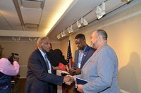Maj. Gen. Alfred Flowers, left, shakes hands with student Larry Johnson, BMI president. With them is alumnus Carl Hall '17, a BMI member who assisted in planning and running the event.