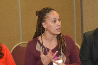 Image of SUNY Empire State College Associate Professor of Anthropology and History Rhianna C. Rogers engaging in conversation with her colleagues.