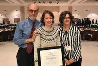 Alan Mandell, college professor of adult learning and mentoring, and Shantih Clemans, director of the Center for Mentoring, Learning and Academic Innovation, join Karen LaBarge, center, holding her award.